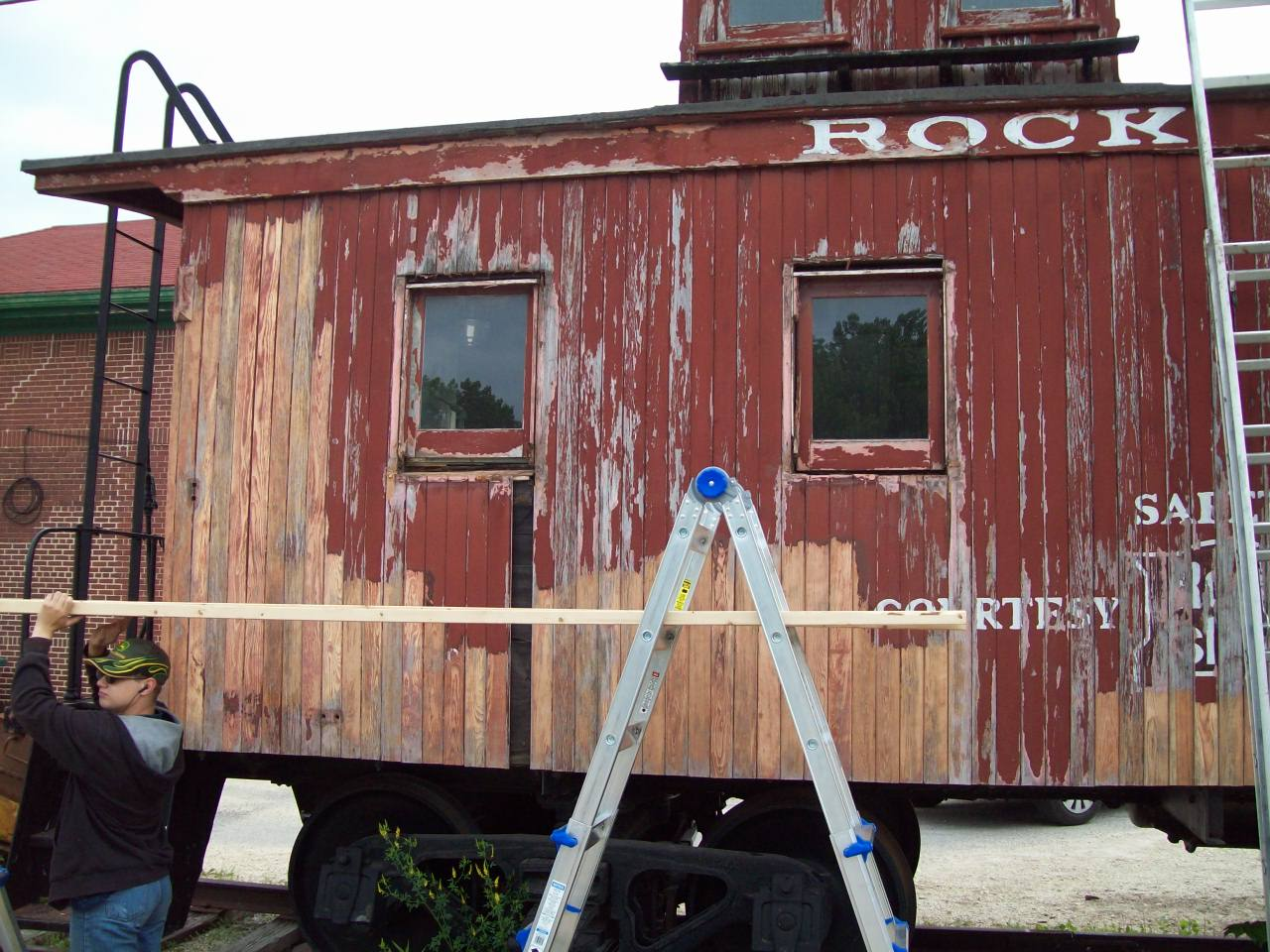 The following photos were taken on June 11, 2009, and show a lot of the hard work and dedication that goes into preserving historic equipment such as this. Chris Parrish sets-up scaffolding as work on the caboose progresses.