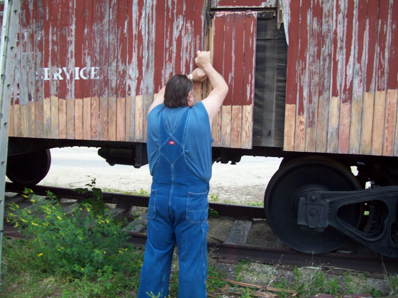 Gene Parrish tackling the task of scraping away the old paint.